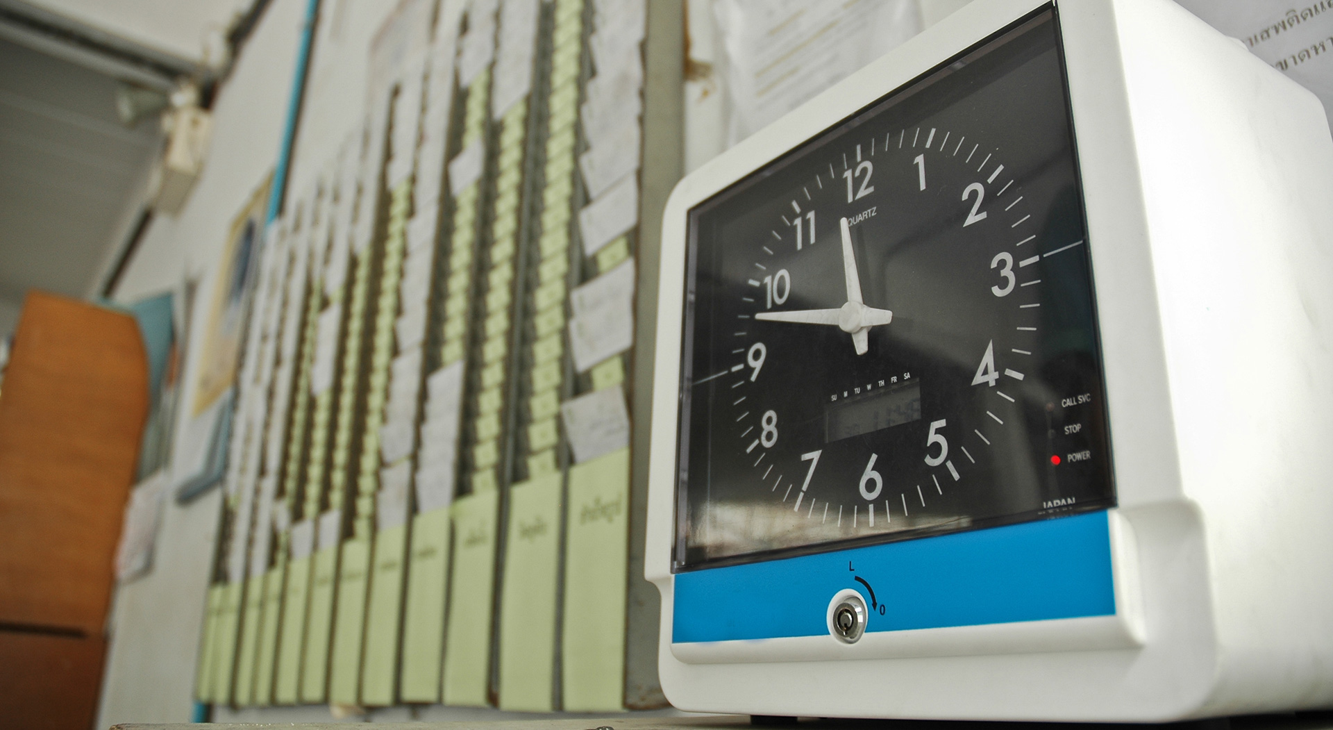 photo of employee time cards and clock